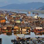 Незвичайні плаваючі міста Китаю (11 фото)